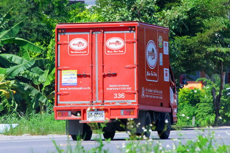 public company: CHIANGMAI, THAILAND - OCTOBER 3 2014: Fast Delivery Truck of PRESIDENT BAKERY PUBLIC COMPANY LIMITED. Photo at road no.121 about 8 km from downtown Chiangmai, THAILAND.