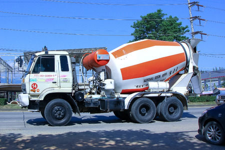 CHIANGMAI, THAILAND-OCTOBER 4 2014: Cement truck of PPS Concrete company. Photo at road no.1001 about 8 km from downtown Chiangmai, thailand.