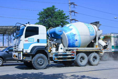 CHIANGMAI, THAILAND - OCTOBER 10 2014 :Concrete truck no.8503 of CPAC Concrete product company. Photo at road no.1001 about 8 km from downtown Chiangmai, thailand.