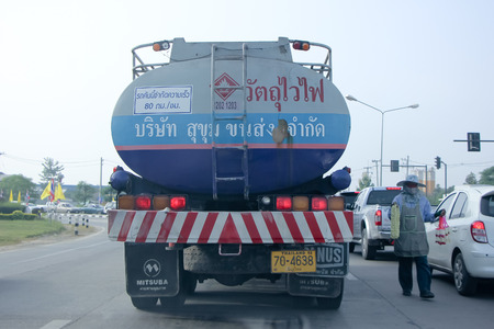 CHIANGMAI, THAILAND -OCTOBER 19 2014 : Sukhum Transport Oil Truck. Photo at road no.1001 about 8 km from downtown Chiangmai, thailand.