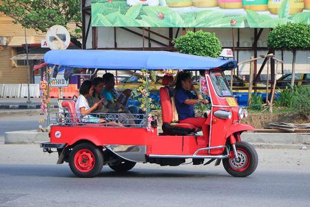 tuk tuk: CHIANGMAI , THAILAND - OCTOBER 20 2014: An unidentified Red Tuk tuk taxi chiangmai, Service in city and around.  Photo at New Chiangmai bus station, thailand.