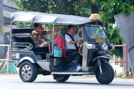CHIANGMAI, THAILAND -OCTOBER 18 2014: Tuk tuk taxi chiangmai, Service in city and around. Photo at road no.121 about 8 km from downtown Chiangmai, thailand. Editoriali