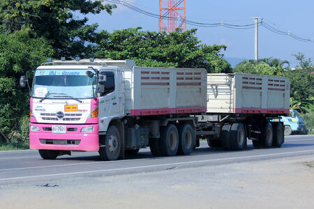 truckload: CHIANGMAI, THAILAND-NOVEMBER 17 2014: Trailer dump truck of Tanachai company.  Photo at road no 121 about 8 km from downtown Chiangmai, thailand. Editorial