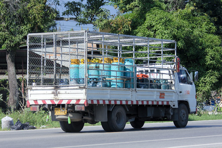 ngv: CHIANGMAI , THAILAND -NOVEMBER 13 2014:  Gas truck of Unique gas company. Photo at road no 121 about 8 km from downtown Chiangmai, thailand.