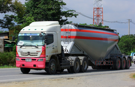 CHIANGMAI, THAILAND - SEPTEMBER 29 2014:  Cement truck of Thanachai company. Photo at road no.121 about 8 km from downtown Chiangmai, thailand.