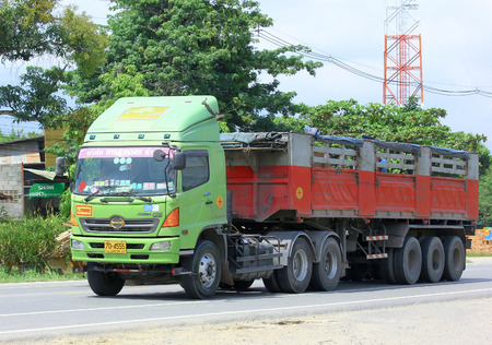 CHIANGMAI, THAILAND - SEPTEMBER 29 2014:  Trailer Truck of Transuvarn transport company. Photo at road no.121 about 8 km from downtown Chiangmai, thailand.