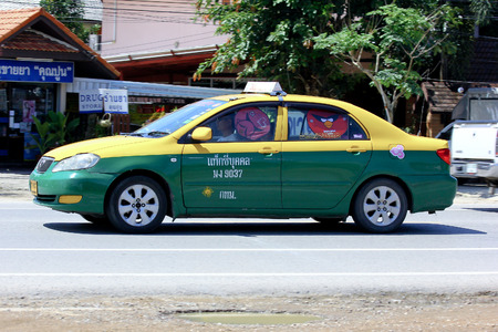 CHIANGMAI, THAILAND - SEPTEMBER 29 2014:  City taxi Bangkok, Service in city. Photo at road no.121 about 8 km from downtown Chiangmai, thailand.