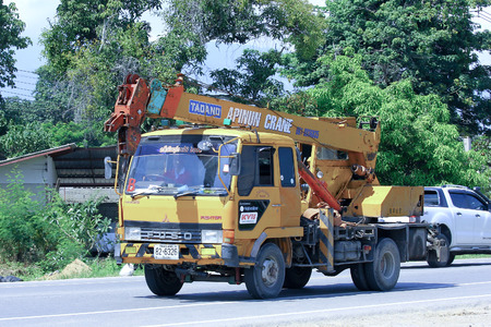 CHIANGMAI, THAILAND - OCTOBER 2 2014: Truck with crane of Aphinan transport. Photo at road no.121 about 8 km from downtown Chiangmai, thailand.