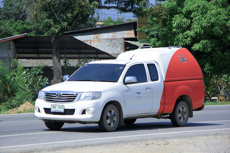 CHIANGMAI, THAILAND - OCTOBER 4 2014: An unidentified Mini truck of Thailand Post. Photo at road no.121 about 8 km from downtown Chiangmai, thailand.