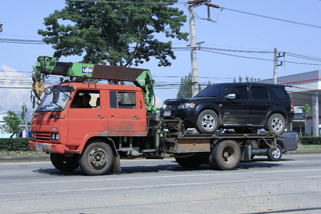 CHIANGMAI, THAILAND - OCTOBER 4 2014: Private Slide up tow truck for emergency car move. Photo at road no 121 about 8 km from downtown Chiangmai, thailand.