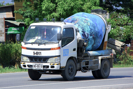CHIANGMAI, THAILAND - OCTOBER 10 2014: Concrete truck of CPAC Concrete product company. Photo at road no.121 about 8 km from downtown Chiangmai, thailand.
