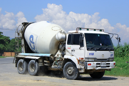 CHIANGMAI, THAILAND - OCTOBER 10 2014: Concrete truck of Chiangmai Concrete product company. Photo at road no.121 about 8 km from downtown Chiangmai, thailand.
