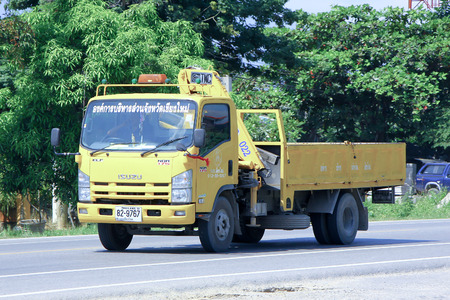 CHIANGMAI, THAILAND - OCTOBER 10 2014: Truck with Crane of Chiang Mai Provincial Administrative Organization.  Photo at road no 121 about 8 km from downtown Chiangmai, thailand.
