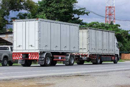 CHIANGMAI, THAILAND -OCTOBER 6 2014: Trailer Truck of Serichai Phatthana 2004 Transportation company. Photo at road no.121 about 8 km from downtown Chiangmai, thailand.
