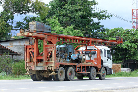 CHIANGMAI, THAILAND -OCTOBER 6 2014:  Pornprasert Truck with crane for foundation pile . Photo at road no.121 about 8 km from downtown Chiangmai, thailand.