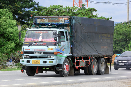 CHIANGMAI, THAILAND -OCTOBER 6 2014: Truck of Ko Kiattichai Phatthana Transport company. Photo at road no.121 about 8 km from downtown Chiangmai, thailand.