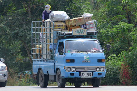 CHIANGMAI, THAILAND -OCTOBER 10 2014: Truck of Paiwan Transport company. Photo at road no.121 about 8 km from downtown Chiangmai, thailand.