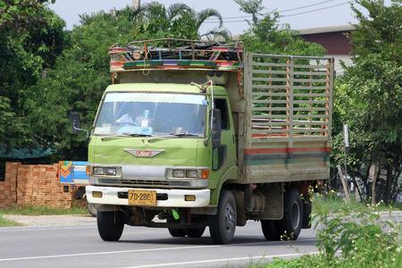 CHIANGMAI, THAILAND -OCTOBER 10 2014:  Truck of Kriangkrai Jaruen Transport company. Photo at road no.121 about 8 km from downtown Chiangmai, thailand.