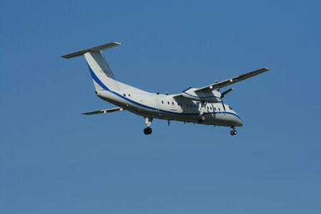 bombardier: CHIANGMAI , THAILAND- NOVEMBER 11 2008: Private aircraft, N505LL Bombardier Dash 8 - Q315.  Landing to Chiangmai airport.