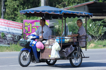CHIANGMAI, THAILAND -OCTOBER 25 2014:  Private Motorcycle taxi. Service in Village. Photo at road no 121 about 8 km from downtown Chiangmai, thailand.
