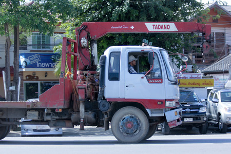 CHIANGMAI, THAILAND -OCTOBER 25 2014: Private Truck with crane. Photo at road no.121 about 8 km from downtown Chiangmai, thailand. Editorial