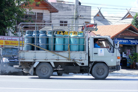 ngv: CHIANGMAI, THAILAND - OCTOBER  25  2014:  Gas mini truck of Unique  gas company. Photo at road no 121 about 8 km from downtown Chiangmai, thailand. Editorial