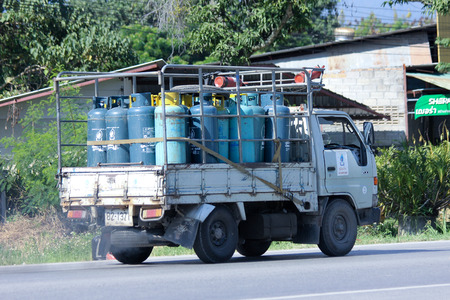 ngv: CHIANGMAI, THAILAND - OCTOBER 30 2014: Gas mini truck of Unique gas company. Photo at road no 121 about 8 km from downtown Chiangmai, thailand. Editorial