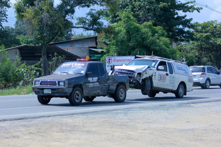 CHIANGMAI, THAILAND - OCTOBER 31 2014:   NMS Tow truck for emergency car move. Photo at road no 121 about 8 km from downtown Chiangmai, thailand.