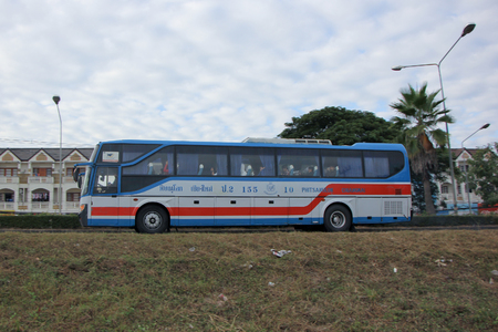 CHIANGMAI, THAILAND - DECEMBER 3 2014: Vintour company bus No.155-10. Route Phitsanulok and Chiangmai.  Photo at road no.11 about 3 km from downtown of Lampang, thailand.
