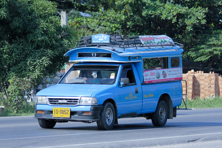 CHIANGMAI, THAILAND - DECEMBER  8 2014:  Blue mini truck taxi, Service between Chiangmai and Lamphun. Photo at road no.121 about 8 km from downtown Chiangmai, thailand.