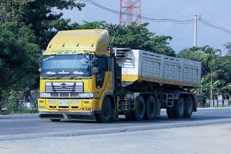 CHIANGMAI, THAILAND - DECEMBER  8 2014: Private Trailer Dump Truck. Photo at road no.121 about 8 km from downtown Chiangmai, thailand.