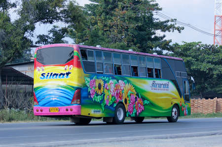 CHIANGMAI, THAILAND - DECEMBER  8 2014:  Travel bus of Silaat Transport Company.  Photo at road no.121 about 8 km from downtown Chiangmai, thailand.