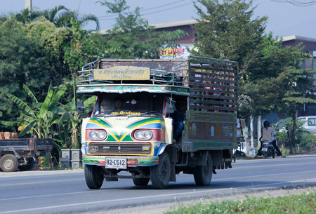 CHIANGMAI, THAILAND - DECEMBER  8 2014: Old Truck of Saha Thip Thong Transport company. Photo at road no.121 about 8 km from downtown Chiangmai, thailand.
