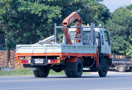 CHIANGMAI, THAILAND - DECEMBER  8 2014: Private Truck with crane.  Photo at road no.121 about 8 km from downtown Chiangmai, thailand.