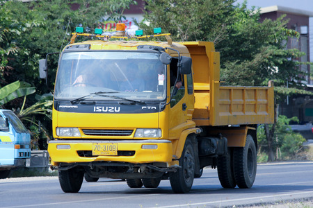 CHIANGMAI, THAILAND - DECEMBER 9 2014: Private Dump Truck. Photo at road no.121 about 8 km from downtown Chiangmai, thailand.
