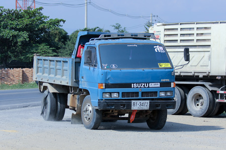 truckload: CHIANGMAI , THAILAND - DECEMBER 11 2014:  Dump Truck of Sor Transport Company. Photo at road no.121 about 8 km from downtown Chiangmai, thailand.