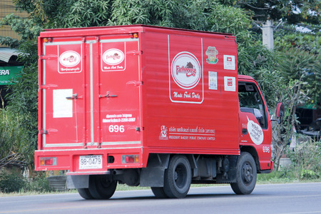 public company: CHIANGMAI, THAILAND - DECEMBER 16 2014:  Fast Delivery Truck of PRESIDENT BAKERY PUBLIC COMPANY LIMITED ( Farmhouse product ). Photo at road no.121 about 8 km from downtown Chiangmai, thailand. Editorial