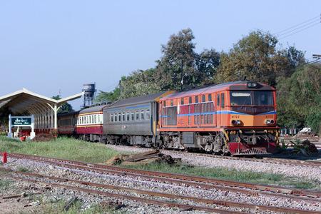 CHIANGMAI, THAILAND- FEBRUARY 5 2014:  Alsthom Diesel locomotive no.4102 and train no.52 from chiangmai to bangkok. Photo at Chiangmai railway station.