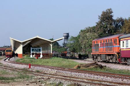 CHIANGMAI, THAILAND- FEBRUARY 5 2014: Alsthom Diesel locomotive no.4102 and train no.52 from chiangmai to bangkok. Photo at Chiangmai railway station. Editorial