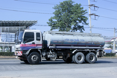 CHIANGMAI , THAILAND - DECEMBER 20 2014: PTT Oil Truck of Sukhum Oil transport Company.  Photo at road no 1001 about 8 km from downtown Chiangmai, thailand.