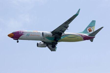 aniversary: CHIANGMAI, THAILAND- FEBRUARY 4 2015: HS-DBQ Boeing 737-800 of NokAir ( 10th Aniversary Livery ), Landing to Chiangmai airport from Bangkok Don Muang Airport.