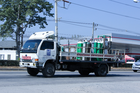 CHIANG MAI, THAILAND - DECEMBER  25 2014:  Gas truck of Lanna industrial gases Company.  Photo at road no 1001 about 8 km from downtown Chiangmai, thailand.