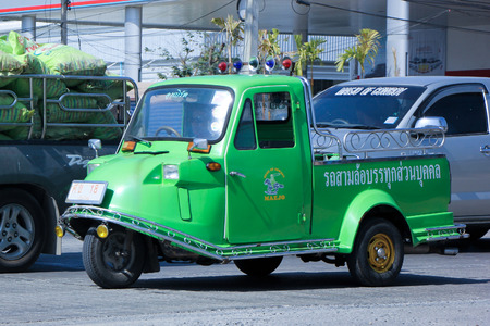 CHIANG MAI, THAILAND - DECEMBER  25 2014: Private Tuktuk car. Photo at road no.1001 about 8 km from city center, thailand.