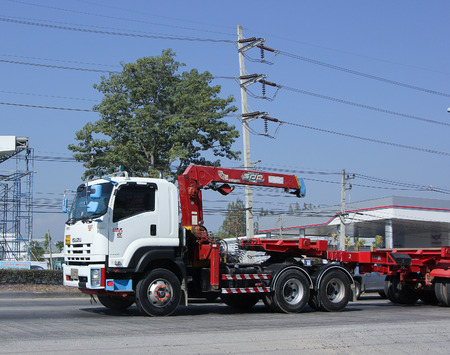 CHIANG MAI, THAILAND - MARCH 5 2015: Trailer Truck with Crane of Chiangmai PK Transport. Photo at road no.1001 about 8 km from downtown Chiangmai, thailand.