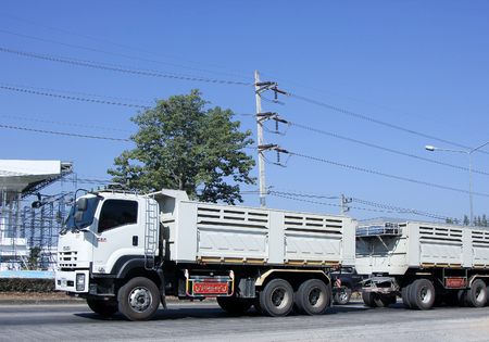 truckload: CHIANG MAI, THAILAND - JANUARY 6 2015: Trailer dump truck of Jaetik Phrae.  Photo at road no.1001 about 8 km from city center, thailand.