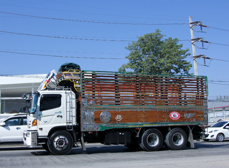 CHIANG MAI, THAILAND - JANUARY 6 2015: Truck of Saha Thip Thong Transport company. Photo at road no 1001 about 8 km from downtown Chiangmai, thailand.