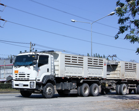 truckload: CHIANG MAI, THAILAND - JANUARY 11 2015:  Trailer dump truck of D stone company.  Photo at road no.1001 about 8 km from city center, thailand. Editorial