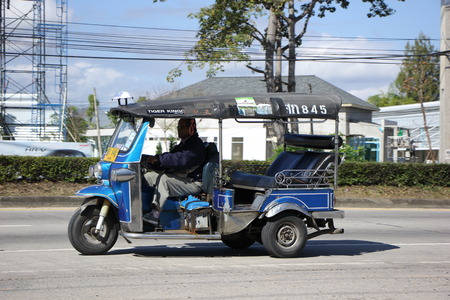 tuktuk: CHIANG MAI, THAILAND - JANUARY 11 2015:  TUKTUK taxi chiangmai, Service in city.  Photo at road no.1001 about 8 km from city center, thailand. Editorial
