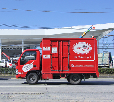 public company: CHIANGMAI, THAILAND - JANUARY 12 2015: Fast Delivery Truck of PRESIDENT BAKERY PUBLIC COMPANY LIMITED ( Farmhouse product ). Photo at road no.1001 about 8 km from downtown Chiangmai, thailand. Editorial