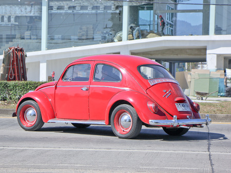 CHIANGMAI, THAILAND -JANUARY 13 2015: Vintage Private Car, Red of Volkswagen beetle.  Photo at road no.1001 about 8 km from downtown Chiangmai, thailand.